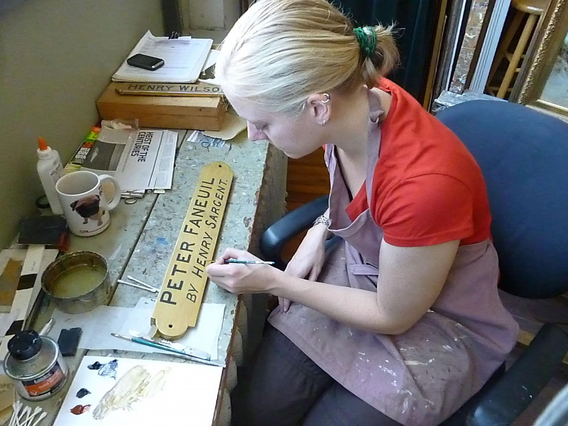 Stephanie working on nameplate